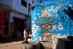 Street graffiti with mustachioed man in turban Royalty Free Stock Image