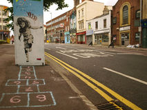 Free Street Graffiti Of A Girl Playing Hopscotch Stock Photo - 16241160