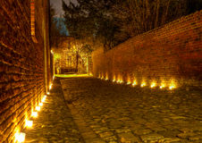 Street in the Great Beguinage, Leuven, Belgium at. Street with cobble pavement at the Great Beguinage (Groot Begijnhof) of Leuven, Belgium, at night lighted Royalty Free Stock Images