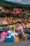 Street grocery, nuts and spices vendor. Samutsakorn Province, Thailand - March 14, 2019: Daily life of street vendors selling variety of nuts, spices, and herbs royalty free stock image