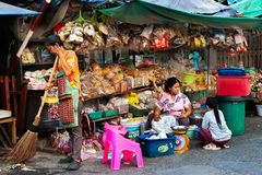Street grocery, nuts and spices vendor. Samutsakorn Province, Thailand - March 14, 2019: Daily life of street vendors selling variety of nuts, spices, and herbs stock photos