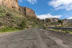 Street with guardrail in mountain roadway. Street with guardrail and double curve road sign in mountain roadway in Gran Canaria Royalty Free Stock Photos