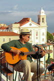 Street guitar player in Alfama quarter. Lisbon . Portugal royalty free stock photo