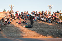 Street guitar player. On the stairs in Florence below Piazzale Michelangelo square . in summer time a lot of people take a drink on some kiosk and take a seat Royalty Free Stock Image
