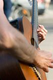 Street guitarist. Guitarist on street performance Stock Photography