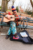Street guitarist. A senior street guitarist in New York Royalty Free Stock Photos