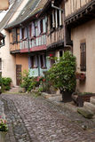 Street with half-timbered  houses in Eguisheim Stock Photography