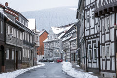 Street with half-timbered houses with snowfall Royalty Free Stock Image