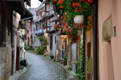 Street with half-timbered medieval houses in Eguisheim Royalty Free Stock Photos