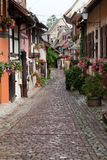 Street with half-timbered medieval houses in Eguisheim Royalty Free Stock Images