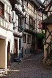 Street with half-timbered medieval houses in Eguisheim Royalty Free Stock Image