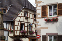 Street with half-timbered medieval houses in Eguisheim Stock Photo