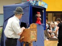 Street hand-organ puppet show Stock Photos