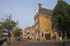Street in Harlingen. Street by canal in Harlingen Royalty Free Stock Photos