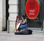 Street harpist Royalty Free Stock Photography