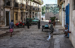 Street of Havana, Cuba. Havana, Cuba - January 5, 2016: Typical scene of one of streets in the center of La Havana - colonial architecture, cars and people Royalty Free Stock Photo