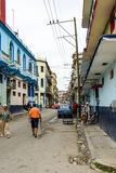 Street of Havana, Cuba. Havana, Cuba - January 8, 2016: Typical scene of one of streets in the center of La Havana - colonial architecture, cars and people Royalty Free Stock Photography