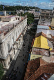 Street of Havana, Cuba. Havana, Cuba - January 5, 2016: Typical scene of one of streets in the center of La Havana - colonial architecture, people walking around Royalty Free Stock Photos
