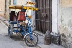 Street in Havana with an  old bicycle and shabby buildings Stock Images