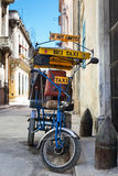 Street in Havana with an  old icycle and shabby buildings Royalty Free Stock Photography