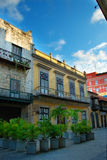 Street in Havana whit Colorful buildings. Detail of typical old Havana architecture with colorful facades and ornamental plants royalty free stock photography