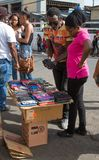 Street hawker in Jamaica trying to sell his merchandise Royalty Free Stock Photo