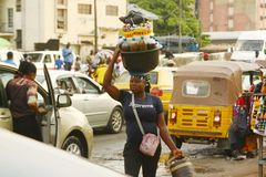 A street Hawker plying her trade Stock Image