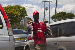 Street hawker. A street hawker sells fruits during a traffic jam in Nairobi, Kenya stock photo