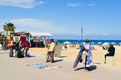 Street hawkers in La Barceloneta in Barcelona, Spain Stock Photos