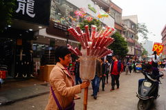 Street hawkers selling Tomatoes on sticks. In Shenzhen, china royalty free stock images