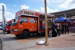 Street hawkers using food trucks to serve their business to the customer. KUALA LUMPUR, MALAYSIA - NOVEMBER 16, 2018: Street hawkers using food trucks to serve stock photo