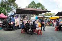 Street hawkers using food trucks to serve their business to the customer. KUALA LUMPUR, MALAYSIA - NOVEMBER 16, 2018: Street hawkers using food trucks to serve royalty free stock images