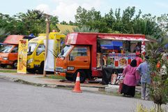 Street hawkers using food trucks to serve their business to the customer. KUALA LUMPUR, MALAYSIA - NOVEMBER 16, 2018: Street hawkers using food trucks to serve royalty free stock image