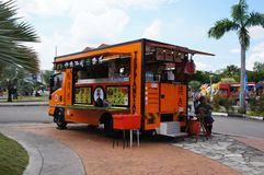 Street hawkers using food trucks to serve their business to the customer. KUALA LUMPUR, MALAYSIA - NOVEMBER 16, 2018: Street hawkers using food trucks to serve royalty free stock photography