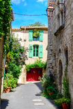 Street in historical center of Pezenas, Languedoc, France. Street decorated with plants  in historical center of Pezenas, Languedoc, France Stock Photography