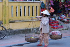 Vendor on the street in Hoi An Stock Image