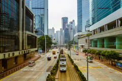 Street in Hong Kong. Cars and tram driving down street in Hong Kong, China Stock Photo
