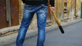 Street hooligan is holding a baseball bat stock footage