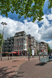 Street with the house in Amsterdam on a day. Stock Photos