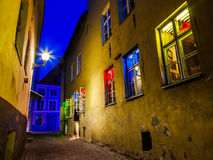 Street and house with illuminated window, Tallinn, Estonia. Medieval street and house with illuminated in different colors window in the Historical Centre of Royalty Free Stock Image
