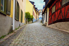 Street with houses and cobblestone Stock Image