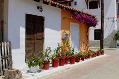Street houses flowerpots, Chalkidiki, Greece Royalty Free Stock Photography