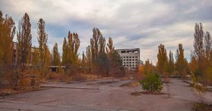 Street and houses among the trees in the empty deserted abandoned town of Pripyat in Ukraine stock image
