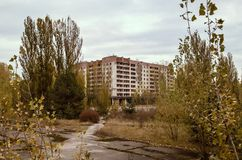 Street and houses among the trees in the empty deserted abandoned town of Pripyat in Ukraine royalty free stock photography