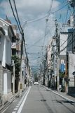 Street hung with electrical wires. Kyoto. Japan stock photo