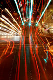 Street Hysteria. Traffic signals and car lights streaked by zooming and movement royalty free stock photography