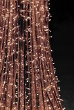 Street illumination in the evening in the new year. Fragment of light decoration on the city streets on holidays - New Year and Christmas stock photography