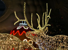 Street ilumination at the night. The deer LED light with illuminated Christmas ball on the horns. Decorative lighting outdoor. Colors: yellow, red, blue Stock Photography