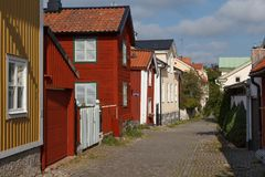 Free Street In The Old Part Of Vasteras Town With Traditional Wooden Stock Photos - 102794443
