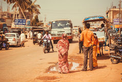 Street of an indian city with drivers, passengers, bikes and transport traffic outdoor Royalty Free Stock Images